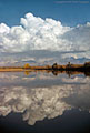 Thunderclouds over the Mesilla Valley and Organ Mountains, reflected in a pool along the Rio Grande River in southern New Mexico